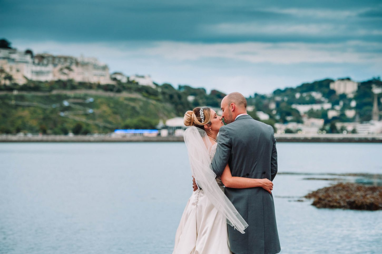 bride & groom on Torquay beach in Devon, Devon wedding photographer
