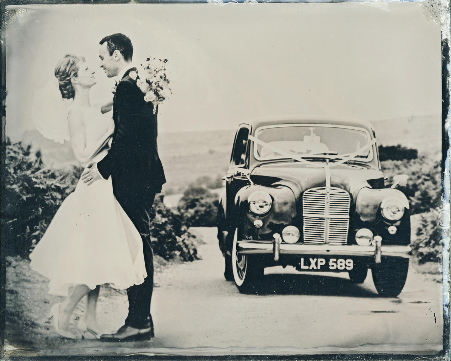 wetplate photograph of bride and groom with vintage car