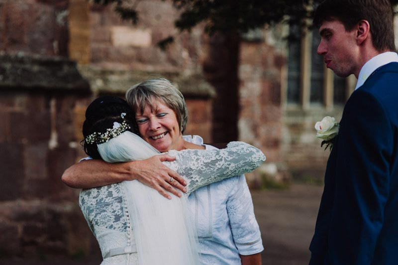 Devon wedding photographer, documentary devon wedding photographer, bride hugging wedding guest at cullompton wedding