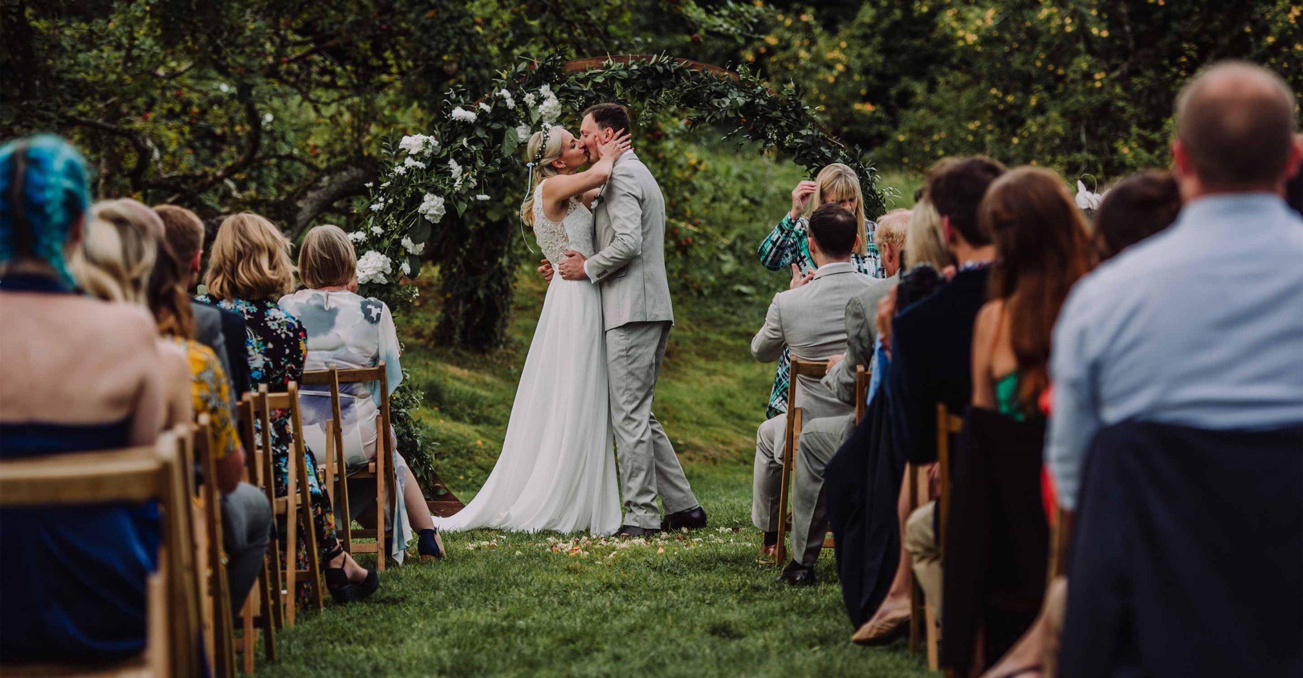 anran wedding photographer, bride and groom first kiss outside wedding, anran wedding devon, anran wedding, devon documentary wedding photographer