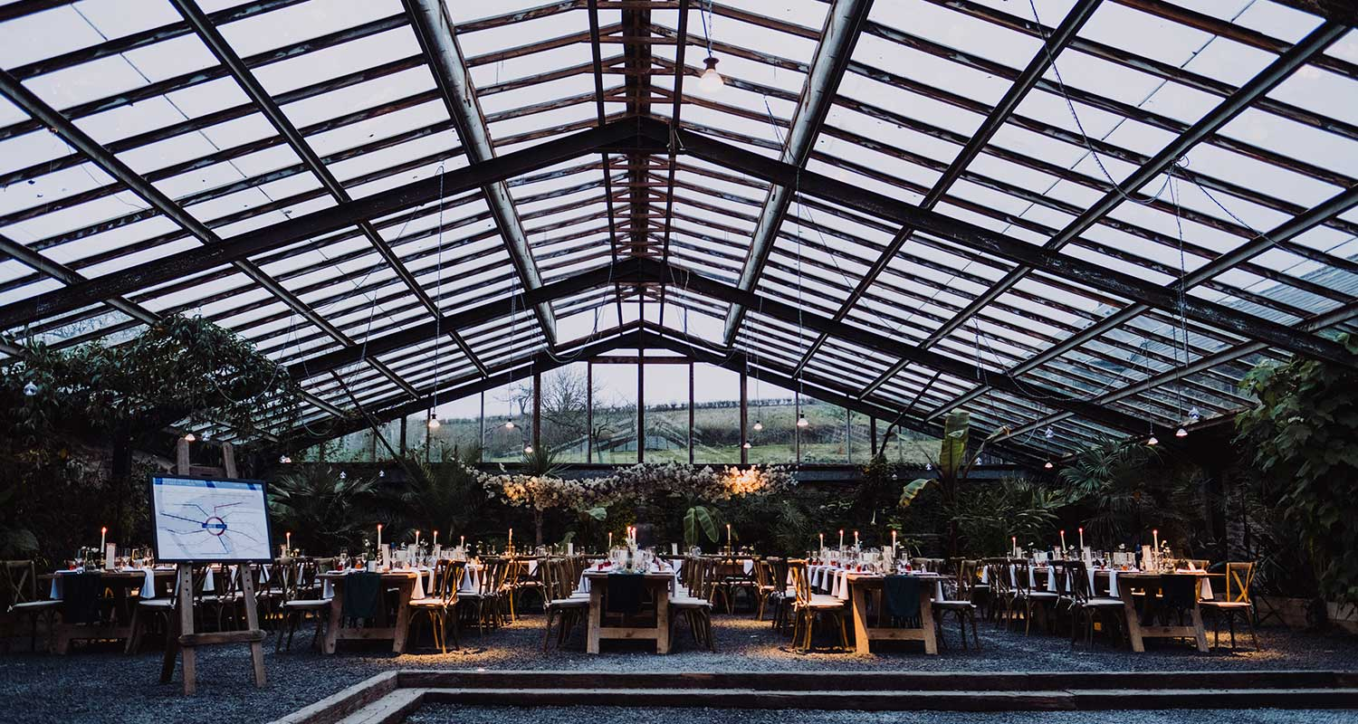 glasshouse at anran in devon, set up with teasel tables for wedding breakfast