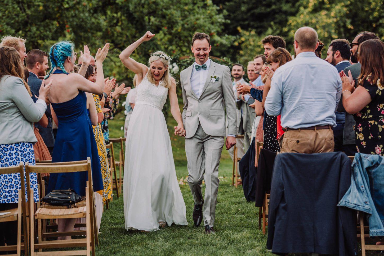 Anran wedding photographer, bride and groom walking down the aisle, devon wedding photographer