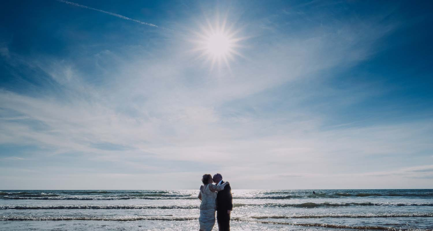 woolacombe beach, bride and groom on a sunny day