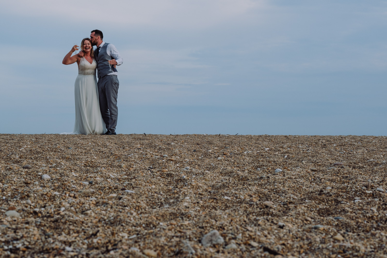 blackpool sands wedding photographer, bride and groom on beach