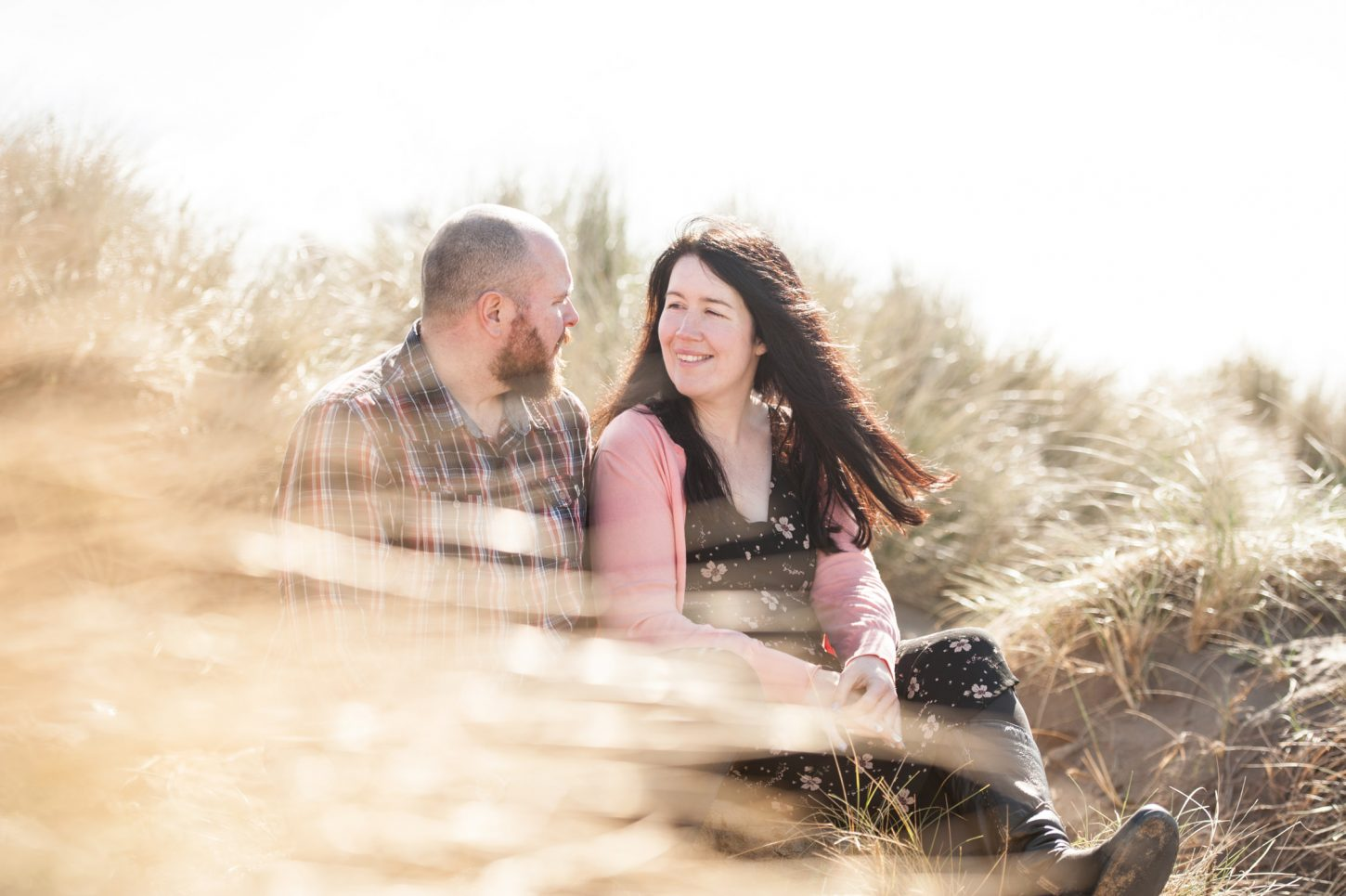 Cornwall wedding photographer capturing couple on Bude beach for a pre-wedding shoot