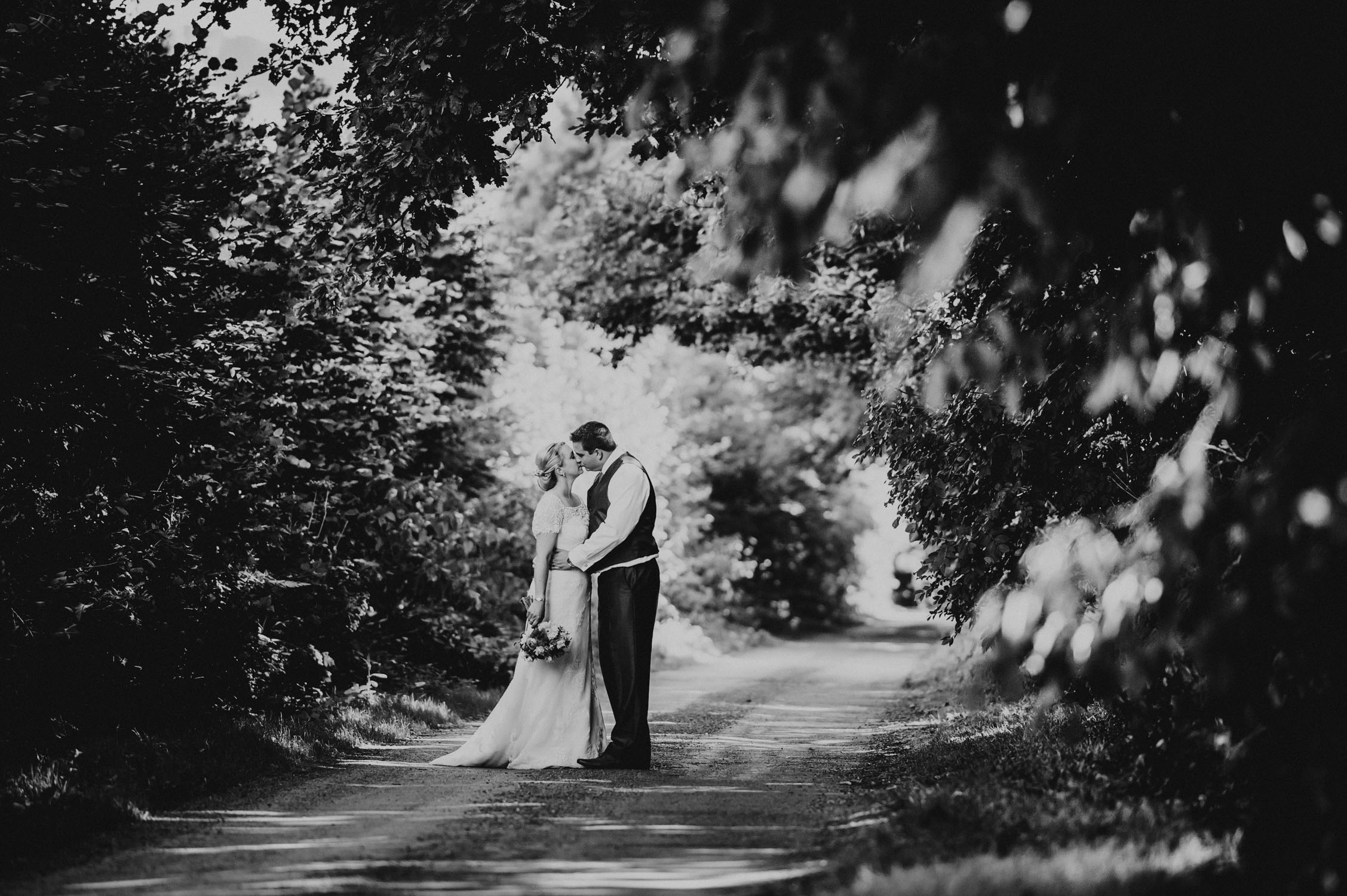 wedding in somerset, bride and groom in lane lined with trees, Documentary somerset wedding photographer