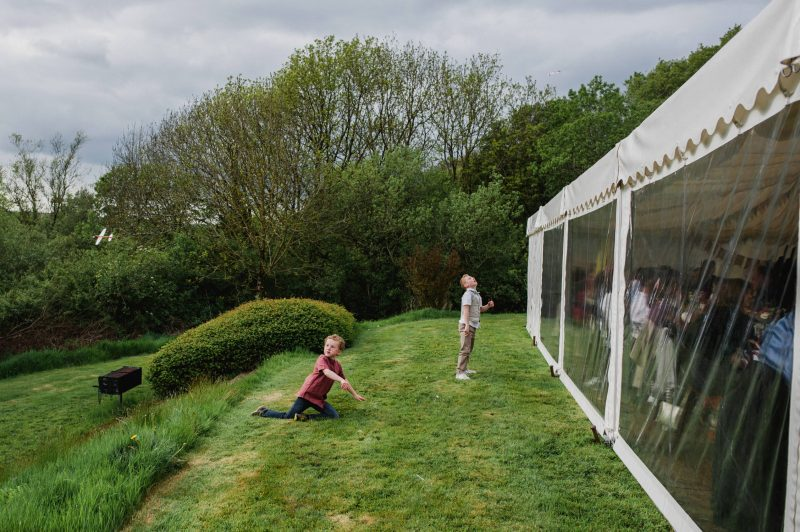 country ways cottages north devon wedding photography, children playing with paper aeroplanes at wedding