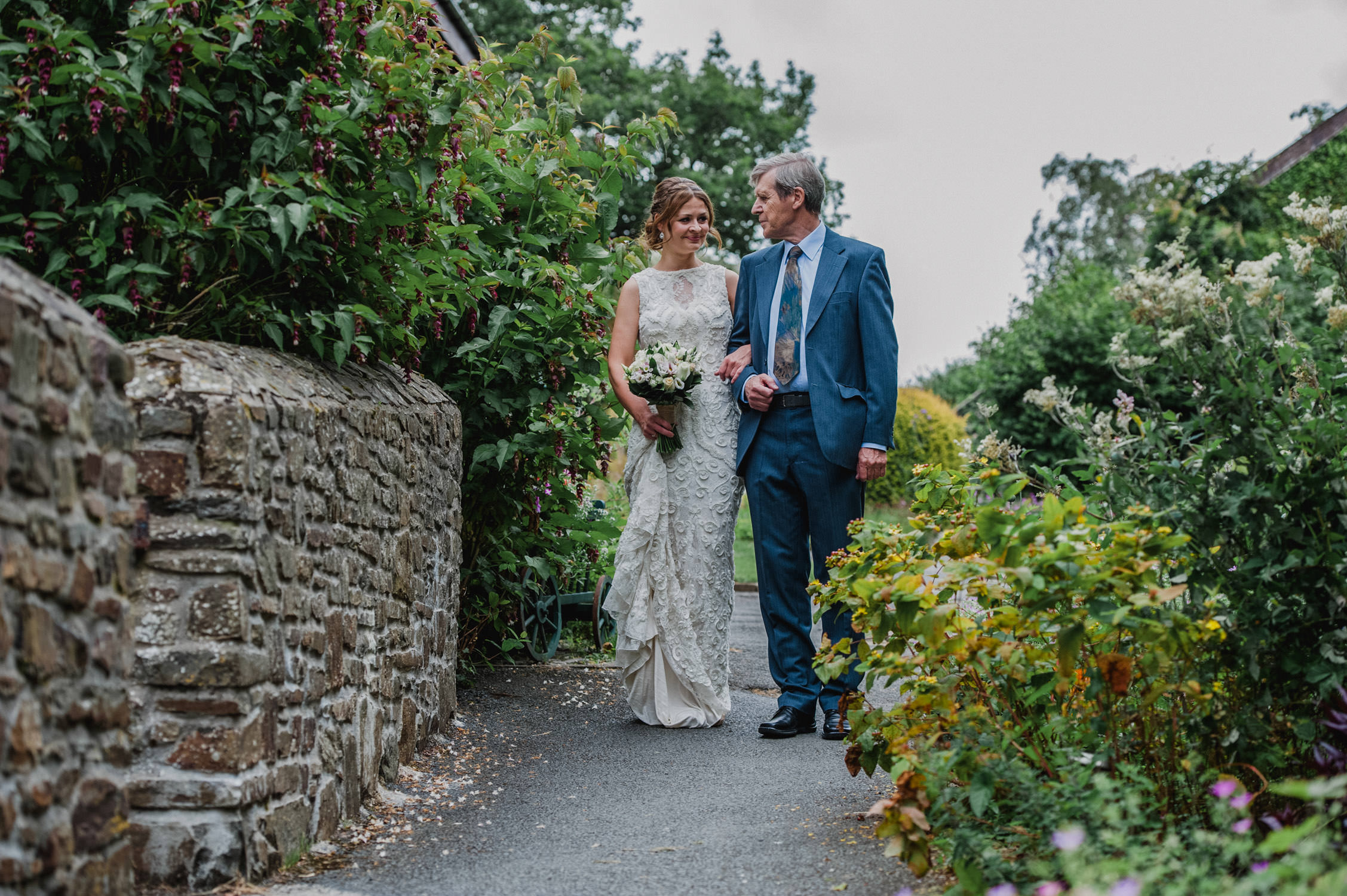 North devon wedding photographer, countryways cottages wedding photography north devon, bride and father walking to ceremony at country ways cottages in north devon