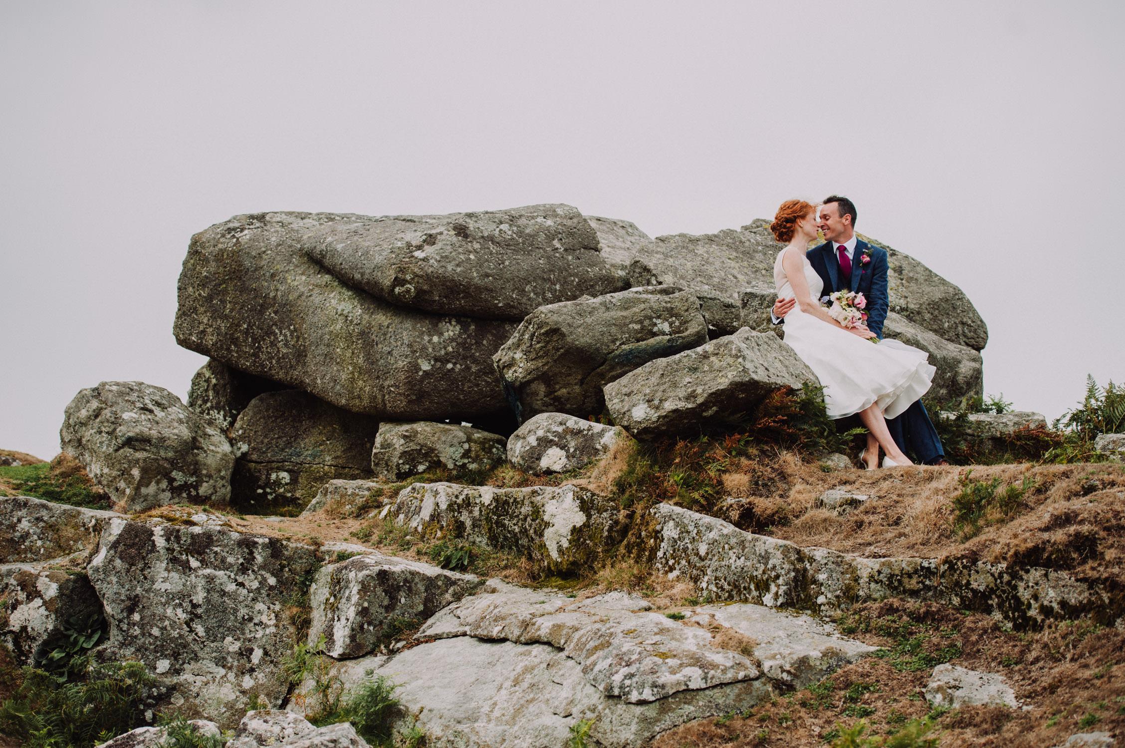 devon wedding photographer - Bride and groom on Dartmoor tor