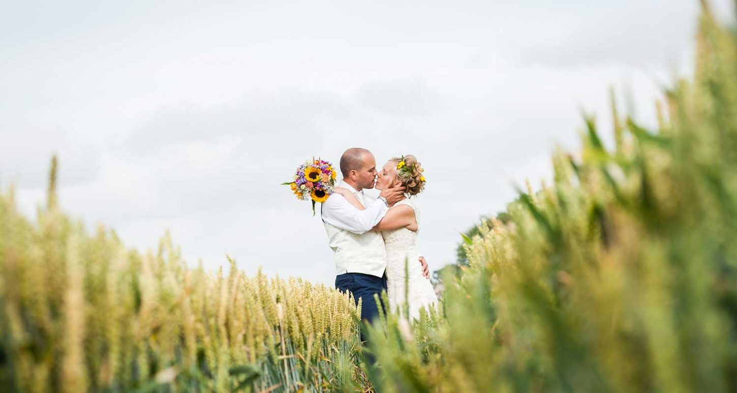 bride & groom in cornfield, Devon wedding photographer