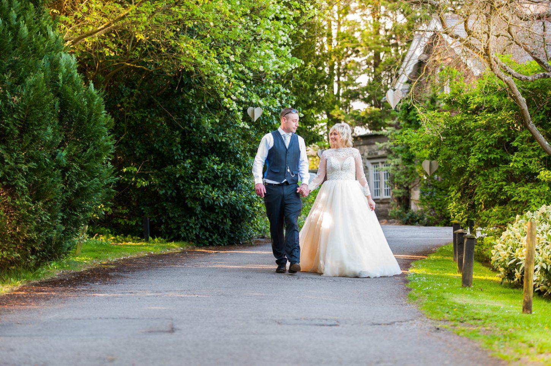 homewood-park-wedding-photography-somerset-, bride and groom walking down homewood park driveway