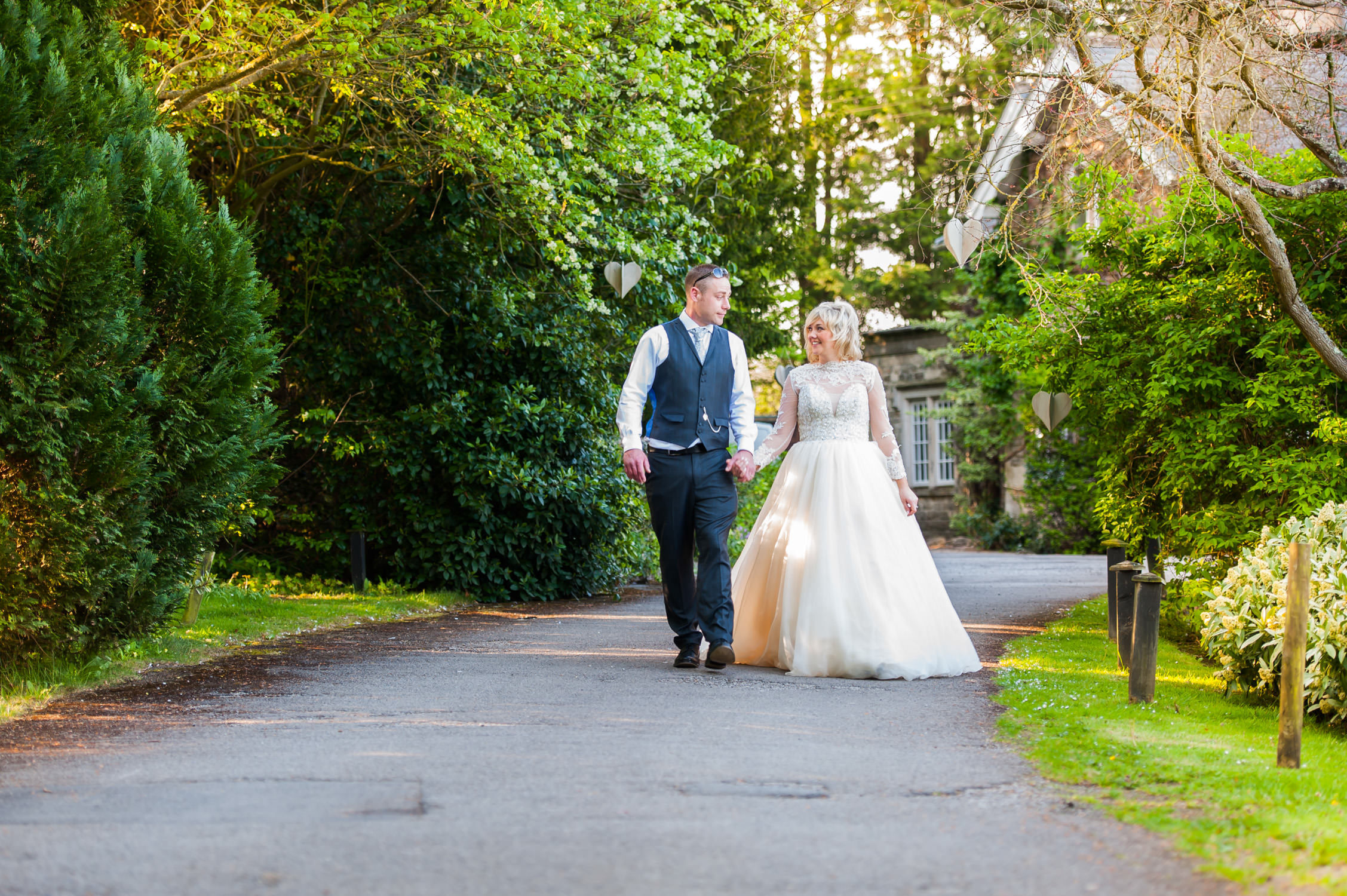 homewood-park-wedding-photography-somerset-, bride and groom walking down homewood park driveway