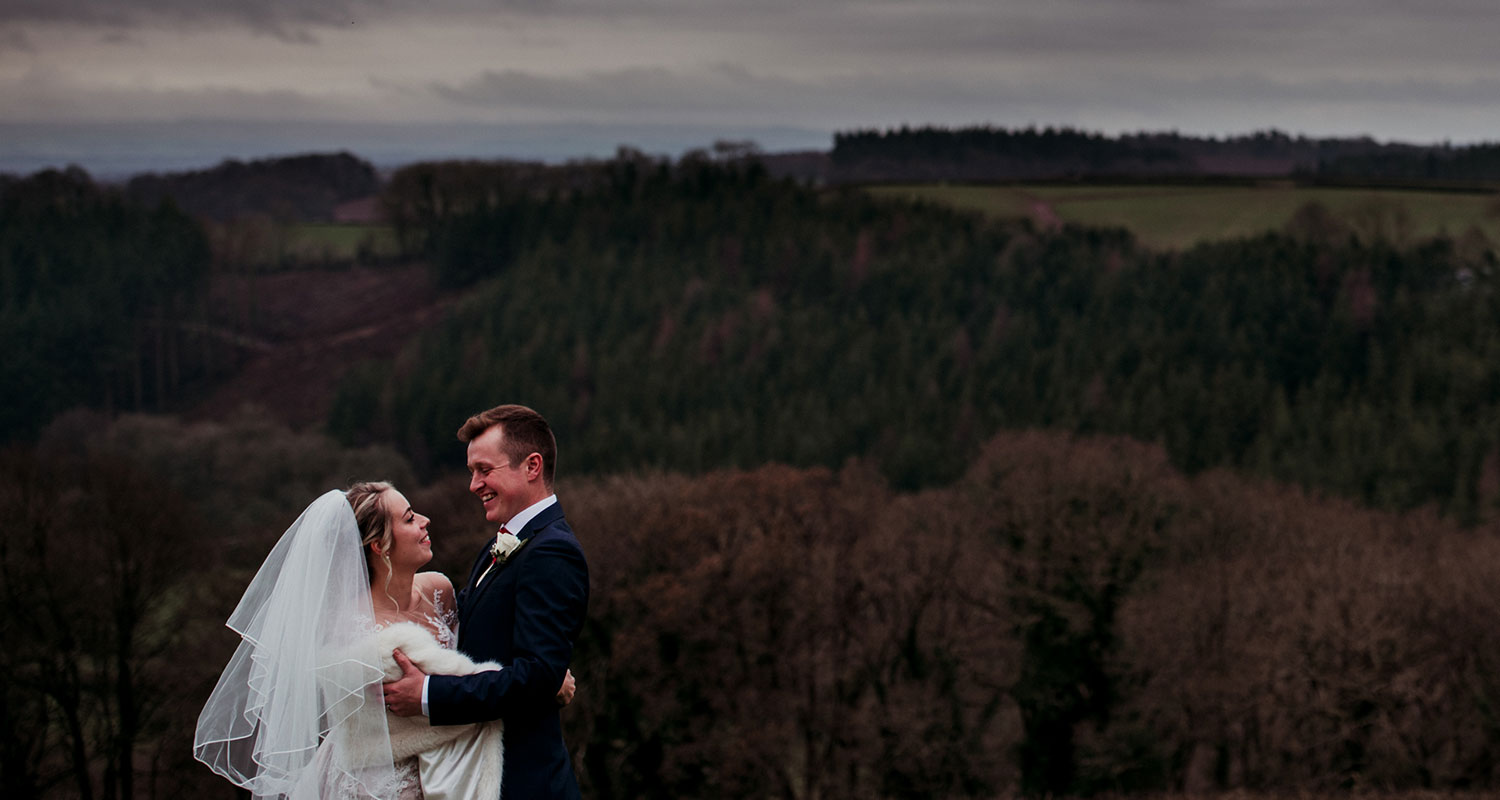 bride and groom in countryside,