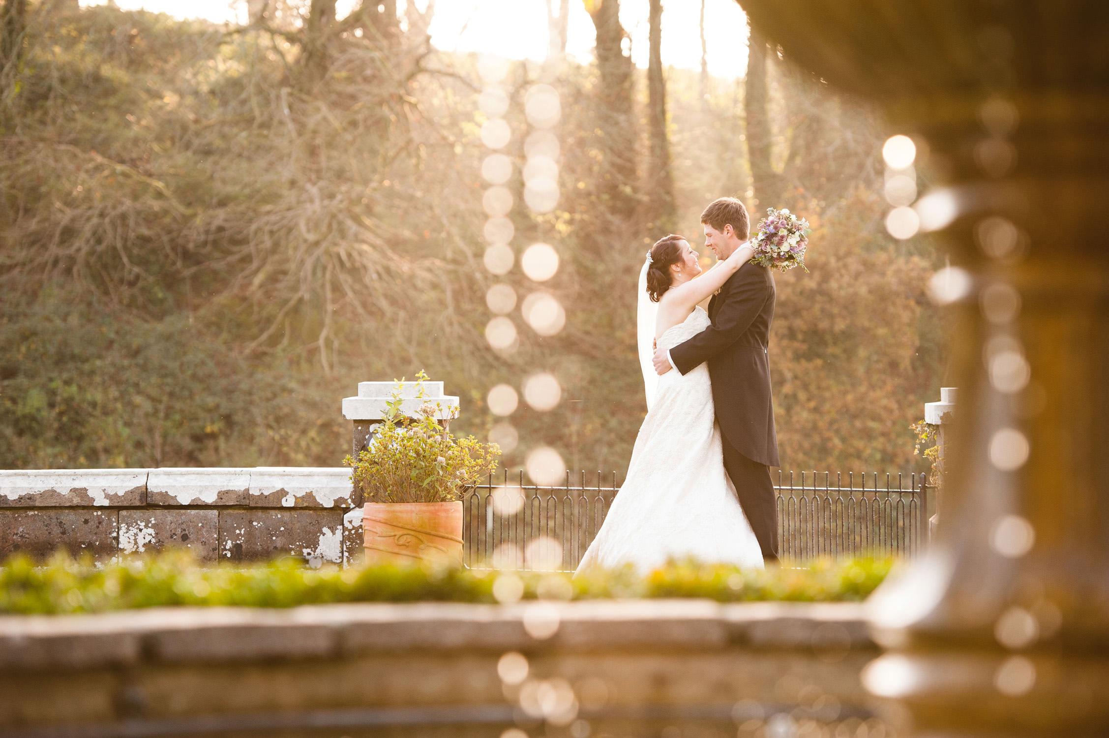 bride and groom fountain at kitley house in Devon, wedding photography devon