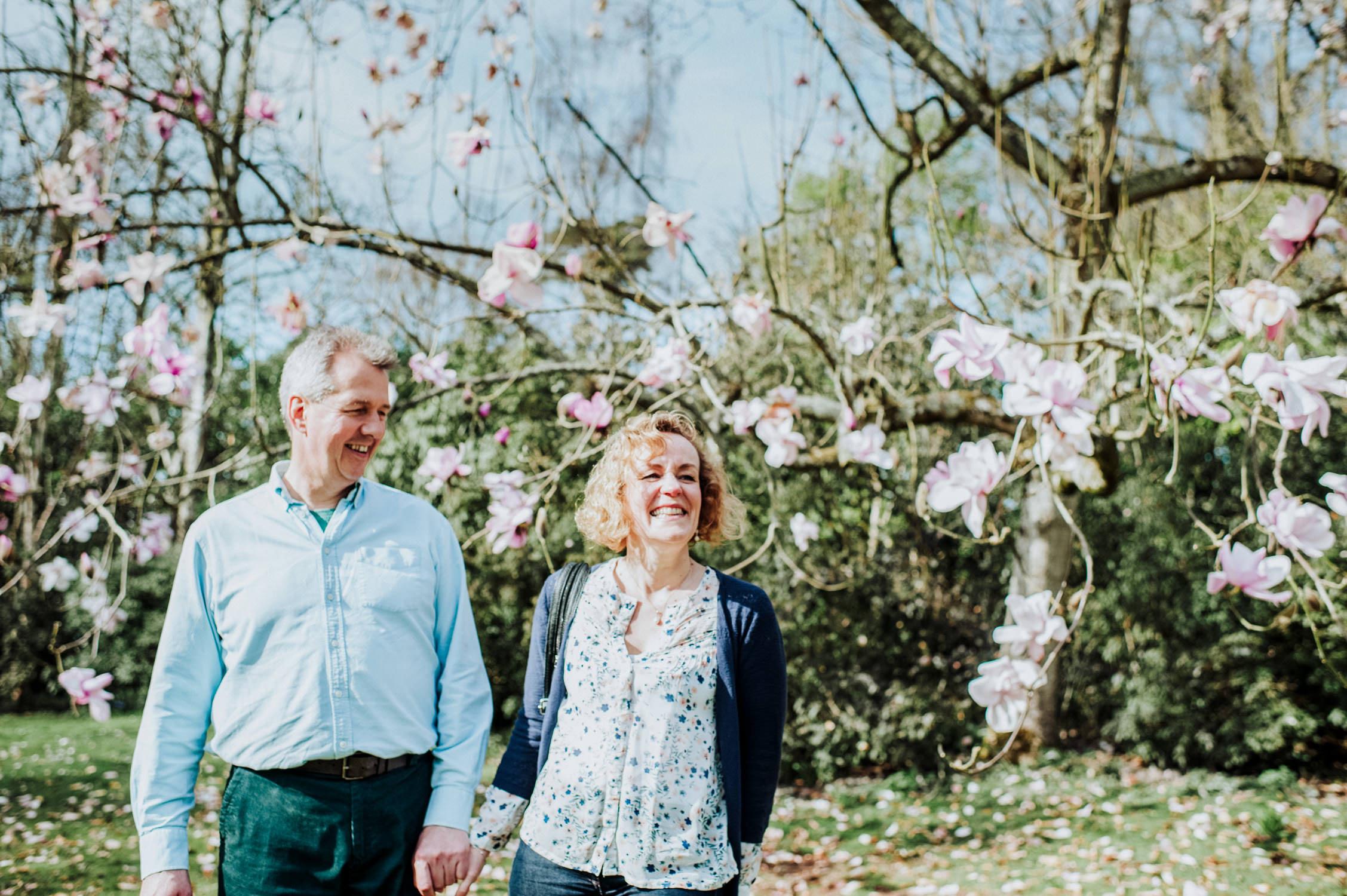 couple next to magnolia tree at knightshayes estate in Tiverton devon, tiverton wedding photographer