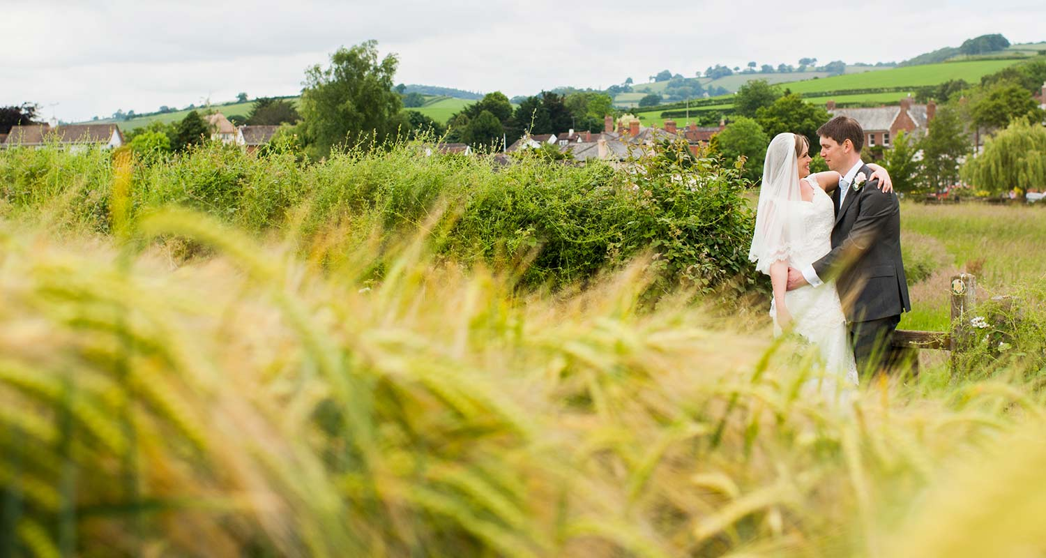 bride and groom in cornfield for elopement wedding