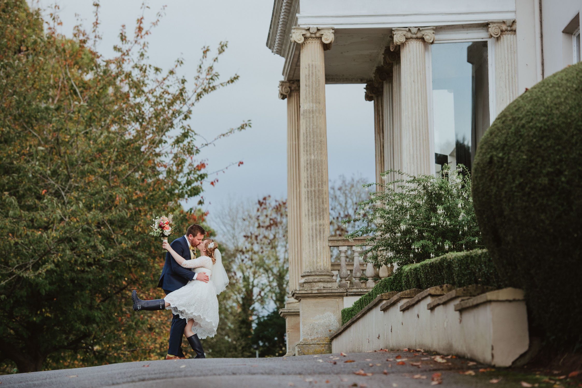 Bride and groom outside mount somerset house in taunton, captured by somerset wedding photographer Anthony Lyons