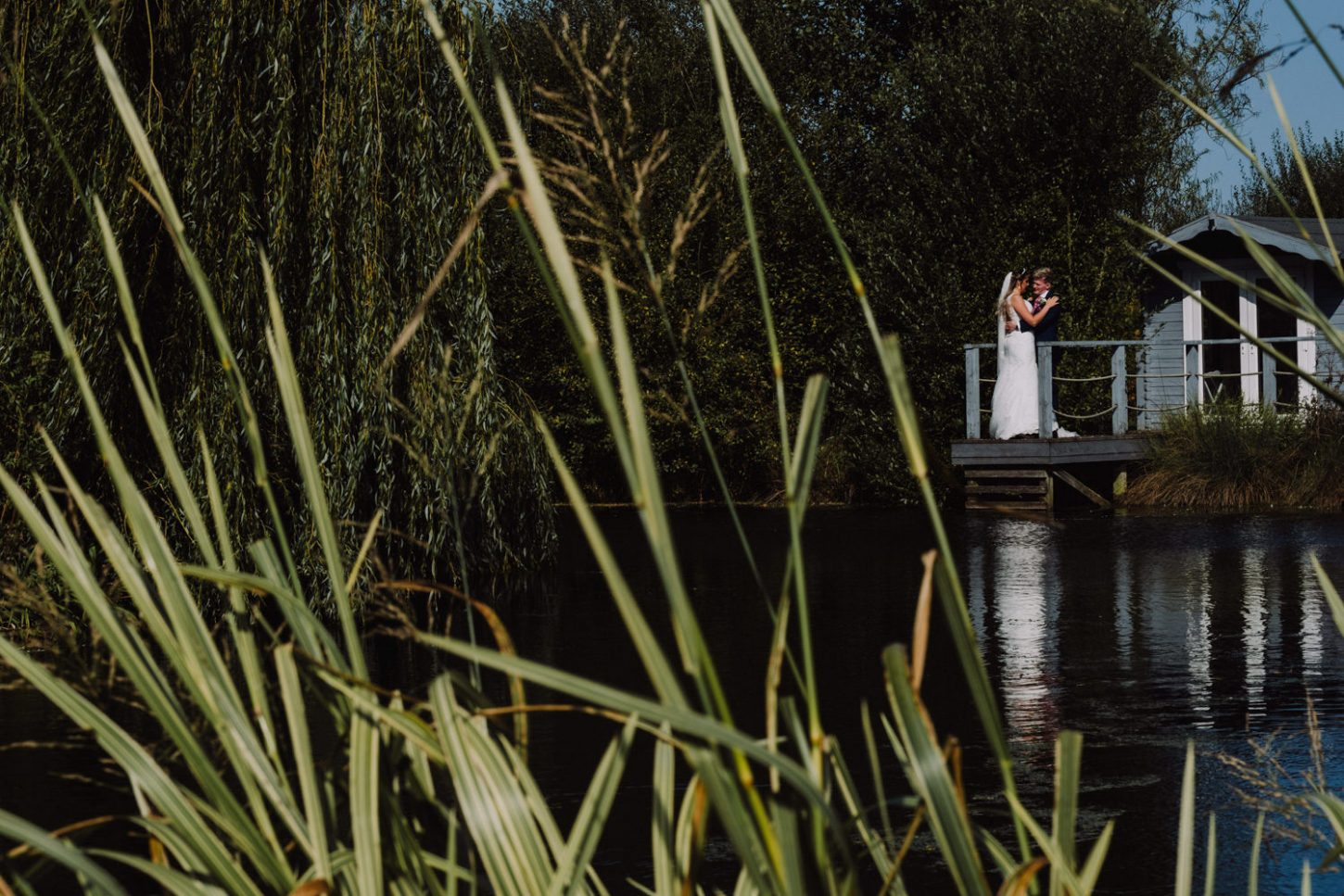 muddifords court wedding, bride and groom at boat house