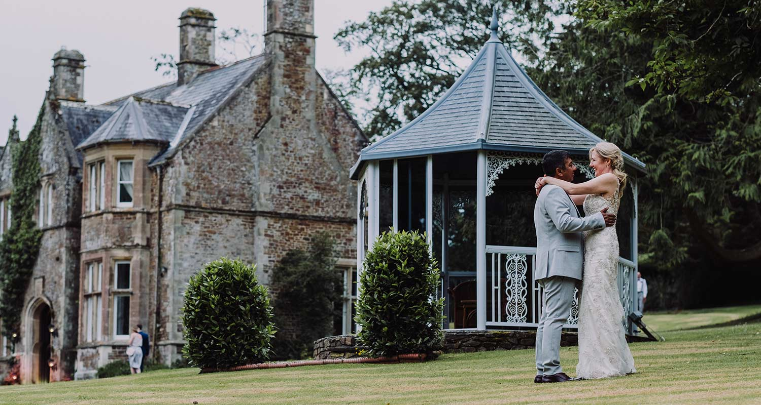 bride and groom outside northcote manor in north devon