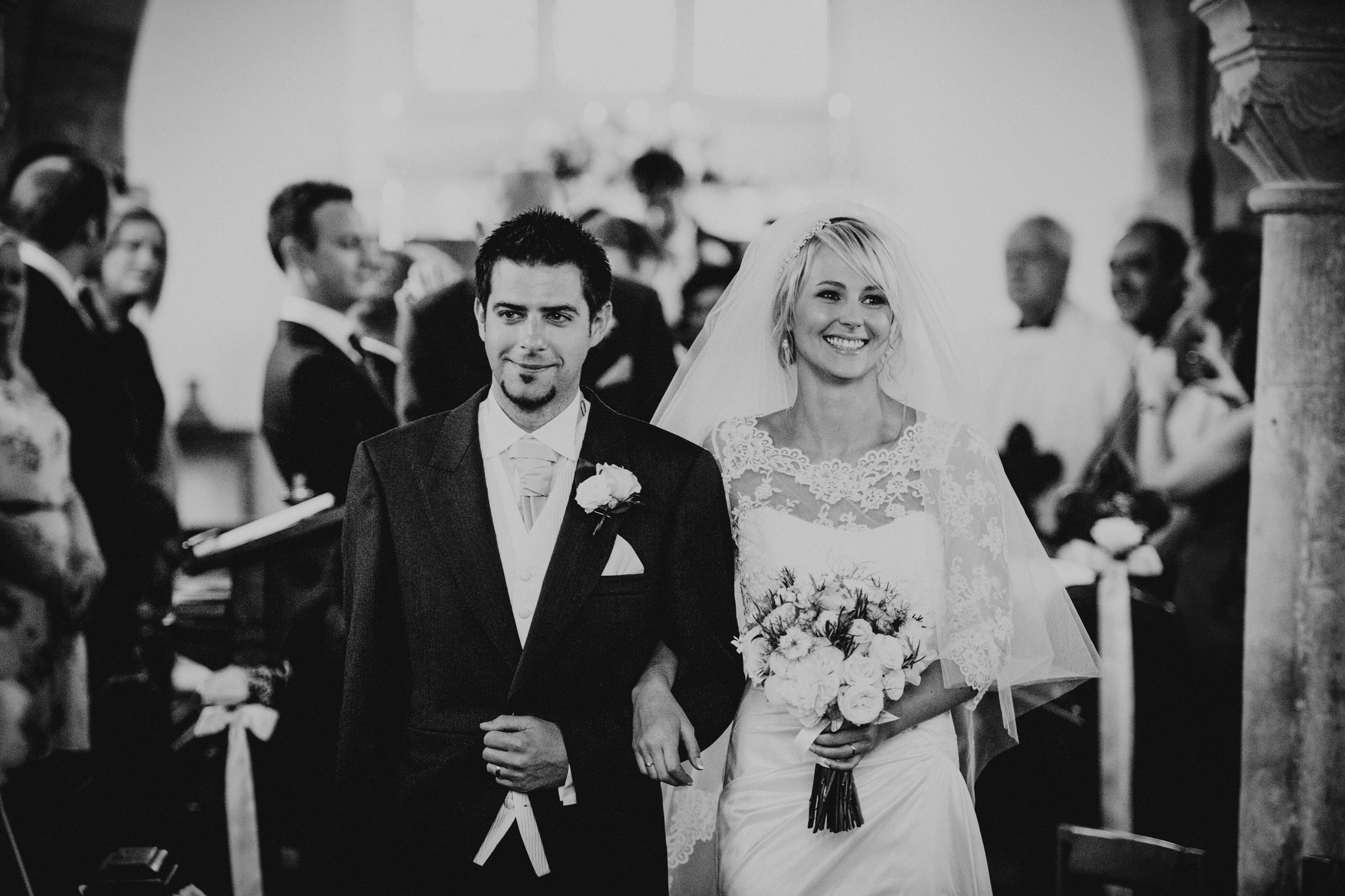 Orchardleigh house wedding, bride and groom walking down the aisle, Devon wedding photographer