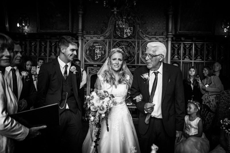 powderham castle devon wedding, bride walking down aisle with grandfather