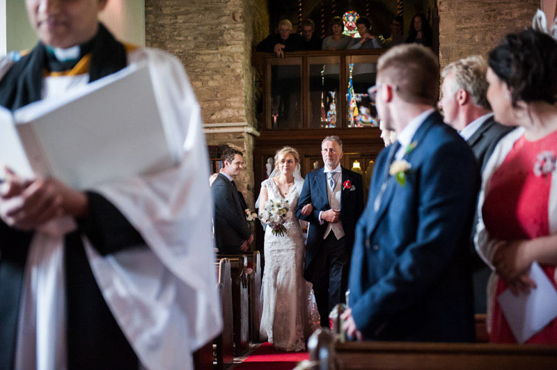 Tiverton wedding photography, bride walking down aisle with father