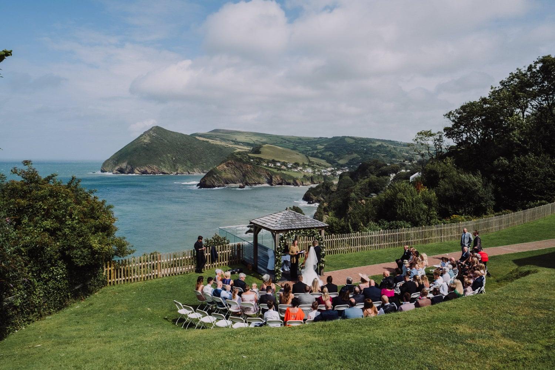 sand cove wedding ceremony outside on cliffs, devon wedding photographer