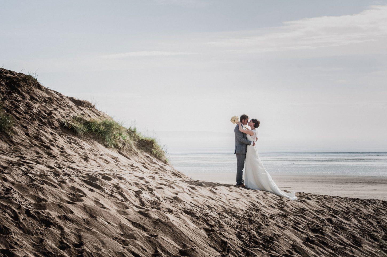 bride and groom on saunton sands in north devon, saunton sands hotel, north devon wedding photographer