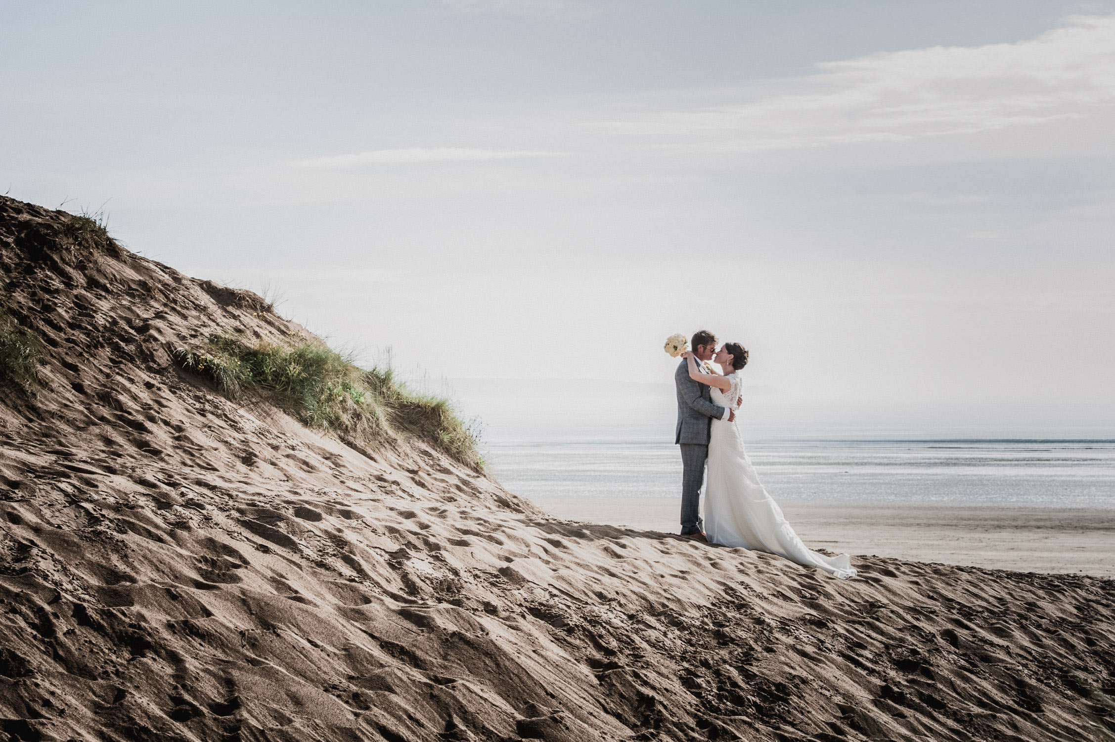 bride and groom on saunton sands in north devon, saunton sands hotel, north devon wedding photographer