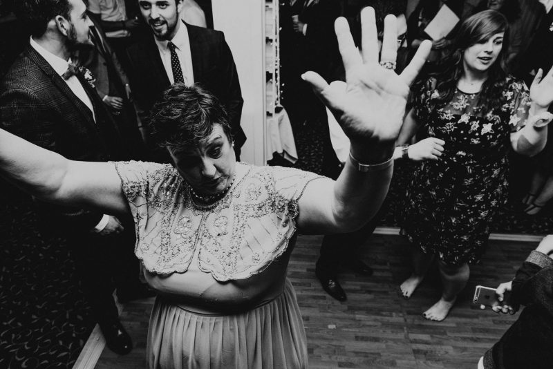 sidmouth harbour hotel wedding photography in devon, mother of the bride feeling the vibe on the dancefloor