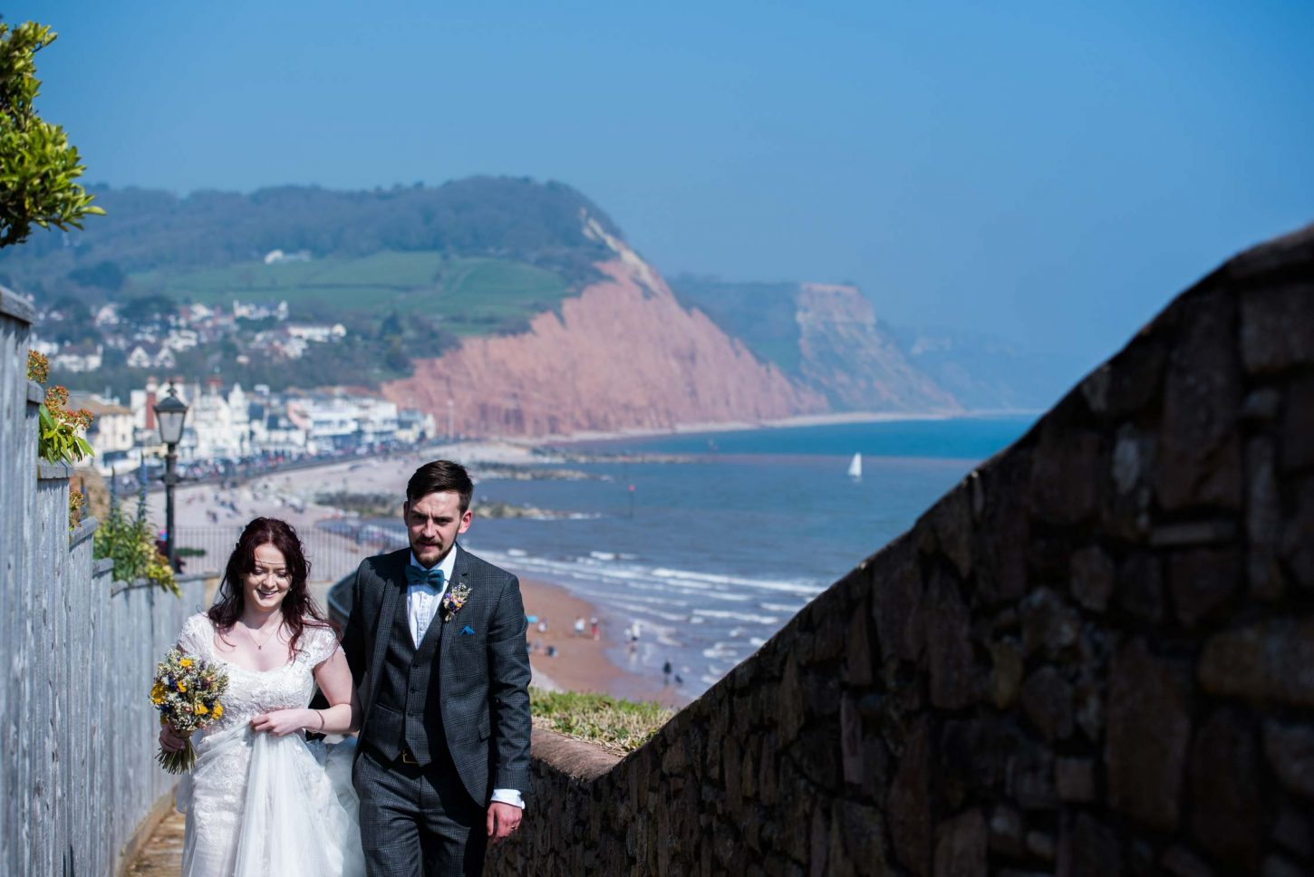 Bride and groom overlooking Sidmouth coast-line seafront coast, Sidmouth harbour hotel wedding photographer