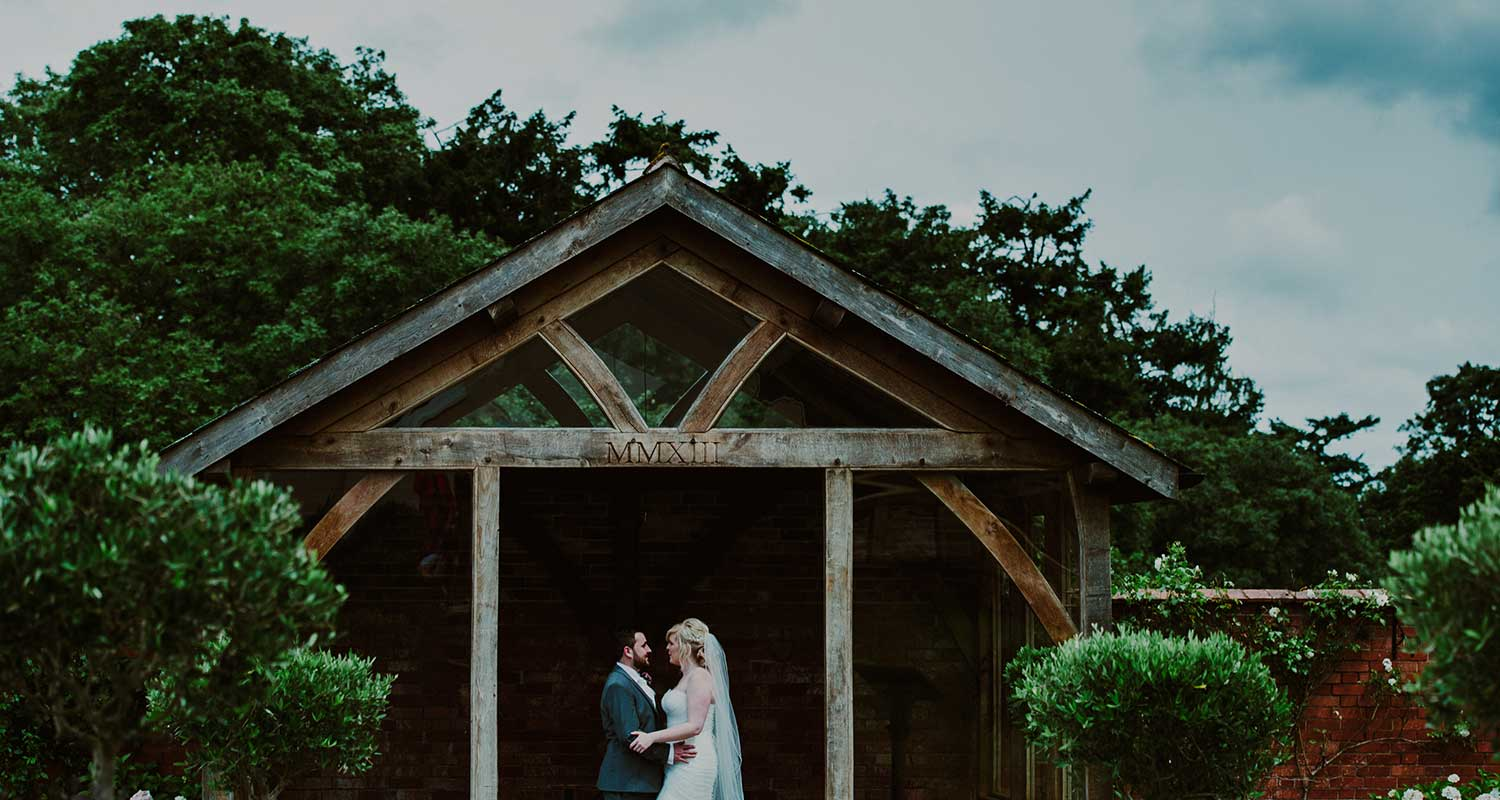Upton Barn and walled garden, Upton barn's arbour, bride and groom in arbour