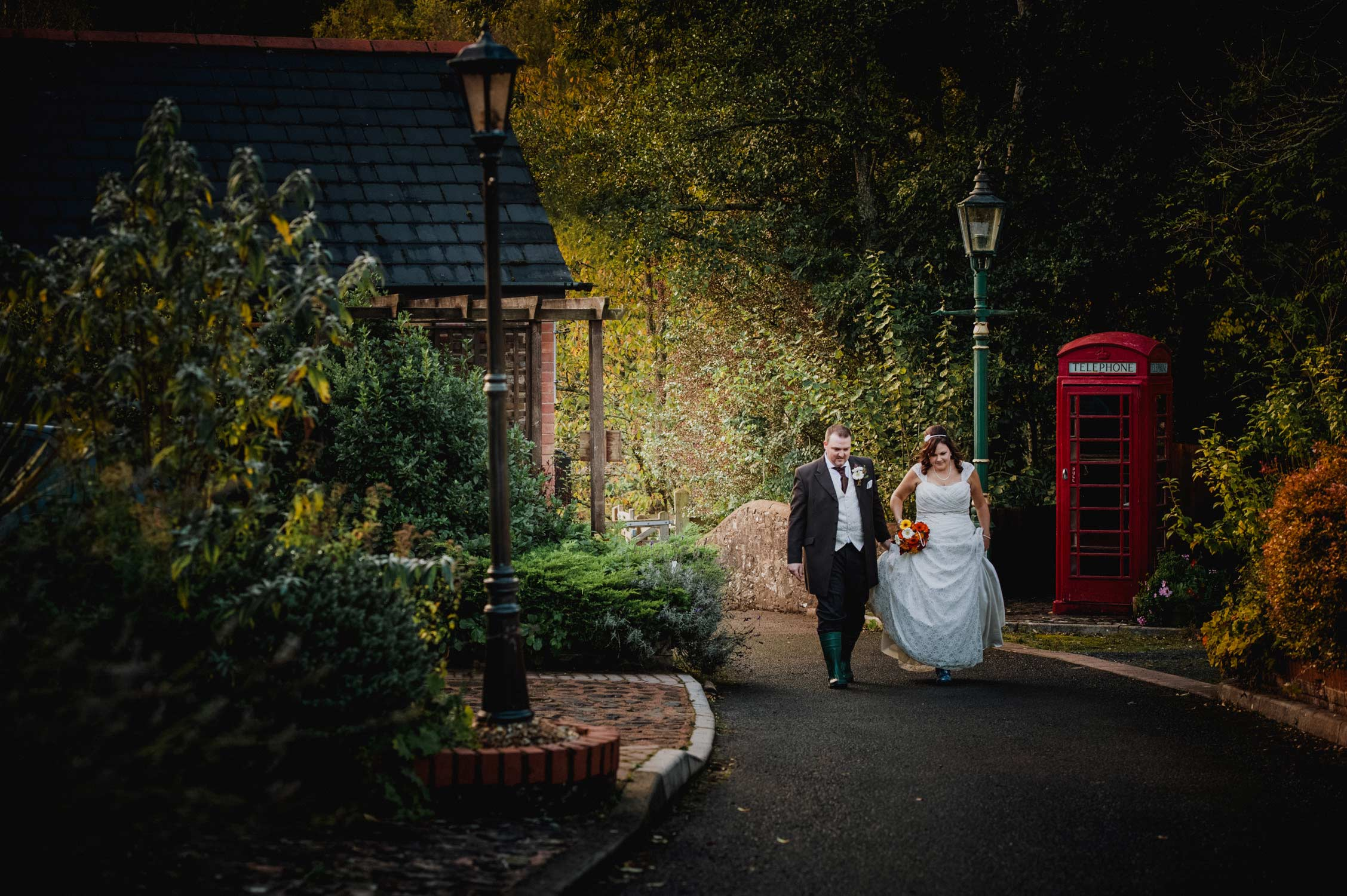 bride and groom walking toward camera at the fox and hounds in devon